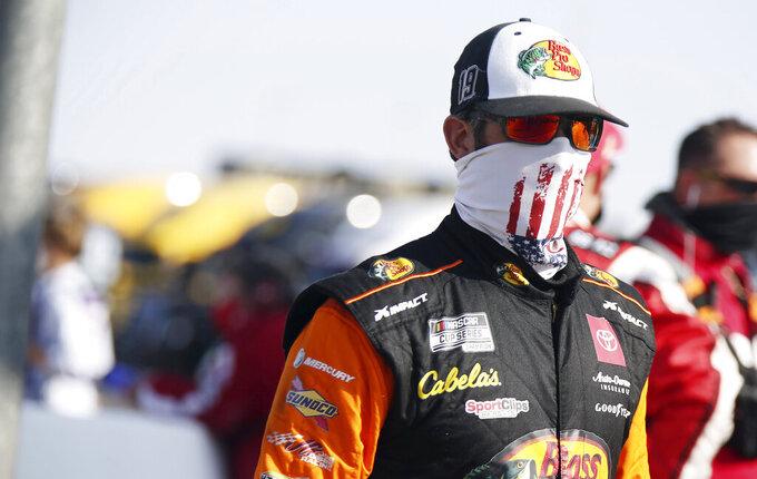Martin Truex Jr. walks to his race car before a NASCAR Cup Series auto race Sunday, Sept. 27, 2020, in Las Vegas. (AP Photo/Isaac Brekken)