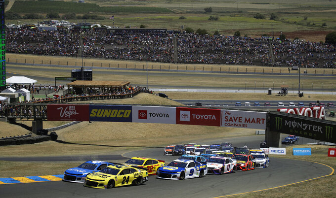 William Byron (24) leads the pack at the start of a NASCAR Sprint Cup Series auto race Sunday, June 23, 2019, in Sonoma, Calif. (AP Photo/Ben Margot)