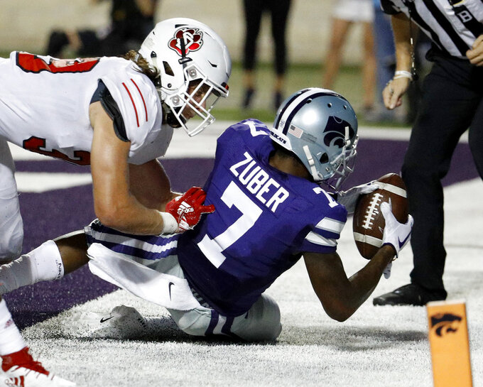 Kansas State wide receiver Isaiah Zuber (7) is tackled in the end zone by South Dakota linebacker Jack Cochrane (39) after scoring a touchdown during the second half of an NCAA college football game Saturday, Sept. 1, 2018, in Manhattan, Kan. Kansas State won 27-24. (AP Photo/Charlie Riedel)