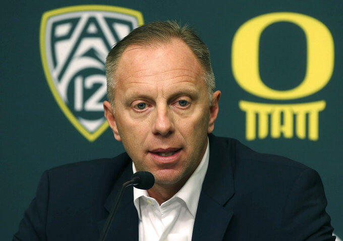"FILE - In this Nov. 29, 2016, file photo, Oregon athletic director Rob Mullens talks to the media in Eugene, Ore., after the firing NCAA college football head coach Mark Helfrich. There are a lot of new voices taking part in the College Football Playoffs selection process. Nearly half of the 13 committee members are serving for the first time. There are six new members taking part in the process to determine the first ranking for this season. It is the biggest turnover since the original group in 2013. The first 2018 ranking comes out Tuesday night, Oct. 30, 2018.  ""Every committee, every group, and every year in unique too, so even if you have the same members, it would be unique because it's a different data set and a different year,"" said Mullens, the fourth-year committee member and new chairman.  (Chris Pietsch /The Register-Guard via AP, File)"