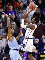 Northwestern forward Vic Law, right, shoots over Columbia forward Randy Brumant during the first half of an NCAA college basketball game Sunday, Dec. 30, 2018, in Evanston, Ill. (AP Photo/Nam Y. Huh)