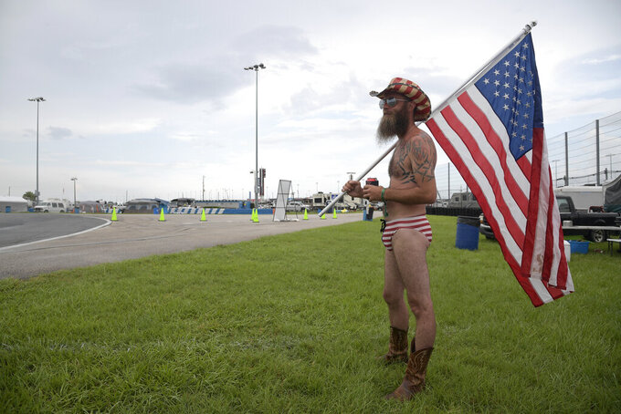 Tony Pacetti stands in the infield with a United States flag before a NASCAR Cup Series auto race at Daytona International Speedway, Saturday, July 6, 2019, in Daytona Beach, Fla. (AP Photo/Phelan M. Ebenhack)