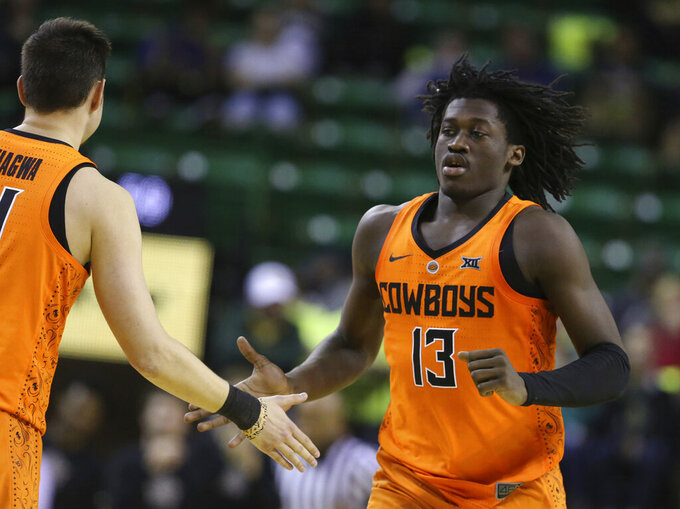 Baylor guard Jackson Moffatt, right, shakes hands with guard Thomas Dziagwa after scoring against Baylor during the second half of an NCAA college basketball game Wednesday, March 6, 2019, in Waco, Texas. (Rod Aydelotte/Waco Tribune Herald via AP)