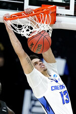Creighton's Christian Bishop dunks the ball against UC Santa Barbara during the first half of a college basketball game in the first round of the NCAA tournament at Lucas Oil Stadium in Indianapolis Saturday, March 20, 2021. (AP Photo/Mark Humphrey)