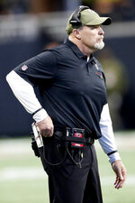 Atlanta Falcons head coach Dan Quinn speaks to his team during the first half of an NFL football game against the Tampa Bay Buccaneers, Sunday, Nov. 24, 2019, in Atlanta. (AP Photo/John Bazemore)