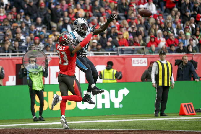 Carolina Panthers wide receiver Curtis Samuel (10) makes a touchdown catch against Tampa Bay Buccaneers cornerback Carlton Davis (33) during the third quarter of an NFL football game, Sunday, Oct. 13, 2019, at Tottenham Hotspur Stadium in London. (AP Photo/Tim Ireland)