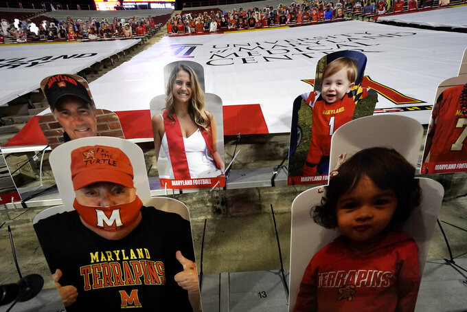 Cutouts are seen on the stands during the first half of an NCAA college football game between Maryland and Minnesota, Friday, Oct. 30, 2020, in College Park, Md. (AP Photo/Julio Cortez)
