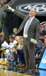 Vermont coach John Becker signals a play to his team during the first half of an NCAA college basketball game against Louisville in Louisville, Ky., Friday, Nov. 16, 2018. (AP Photo/Timothy D. Easley)