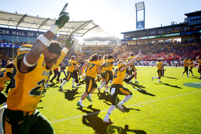 North Dakota State players rush the field after the final play of the FCS championship NCAA college football game against Eastern Washington, Saturday, Jan. 5, 2019, in Frisco, Texas. North Dakota State won 38-24. (AP Photo/Jeffrey McWhorter)