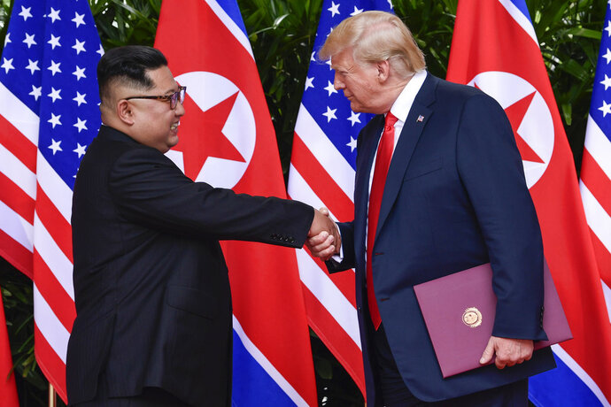 FILE - In this June 12, 2018, file photo, North Korean leader Kim Jong Un, left, and U.S. President Donald Trump shake hands at the conclusion of their meetings at the Capella resort on Sentosa Island in Singapore. U.S. analysts say they have located more than half of an estimated 20 secret North Korean missile development facilities. The findings come as the Trump administration's denuclearization talks with the North appear to have stalled. And they highlight the challenge the U.S. faces in ensuring that North Korea complies with any eventual agreement that covers its nuclear and missile programs.  (AP Photo/Susan Walsh, Pool, File)