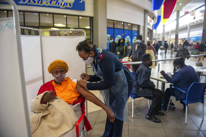 FILE - In this July 6, 2021, file photo, a patient receives a Johnson & Johnson vaccine against COVID-19 in Hammanskraal, South Africa. South Africa's COVID-19 vaccination campaign is regaining momentum after being disrupted earlier this month by a week of riots following the imprisonment of former President Jacob Zuma. (AP Photo/Alet Pretorius, File)