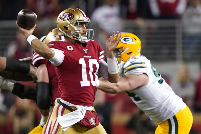 San Francisco 49ers quarterback Jimmy Garoppolo (10) passes against the Green Bay Packers during the second half of the NFL NFC Championship football game Sunday, Jan. 19, 2020, in Santa Clara, Calif. (AP Photo/Tony Avelar)