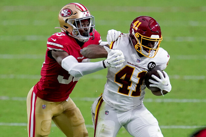 Washington Football Team running back J.D. McKissic (41) is tackled by San Francisco 49ers defensive back Tarvarius Moore (33) during the second half of an NFL football game, Sunday, Dec. 13, 2020, in Glendale, Ariz. (AP Photo/Ross D. Franklin)