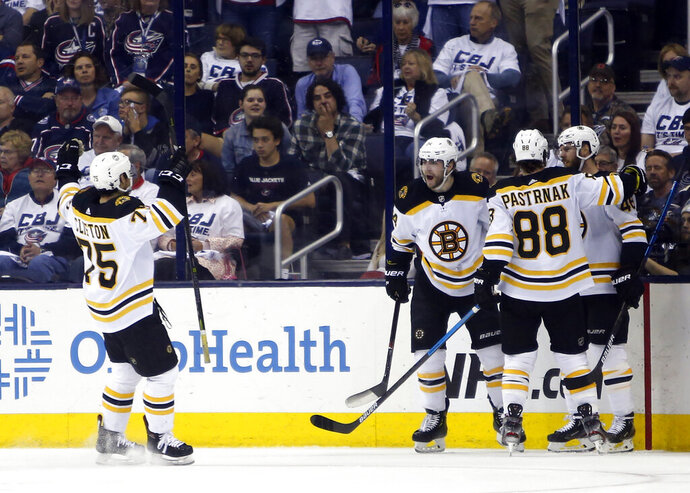 Boston Bruins players celebrate their goal against the Columbus Blue Jackets during the second period of Game 6 of an NHL hockey second-round playoff series Monday, May 6, 2019, in Columbus, Ohio. (AP Photo/Jay LaPrete)
