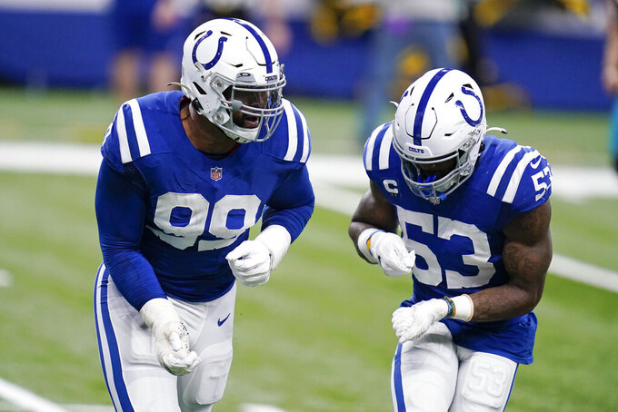 Indianapolis Colts' DeForest Buckner (99) and Darius Leonard (53) celebrate after Buckner sacked Jacksonville Jaguars quarterback Mike Glennon during the first half of an NFL football game, Sunday, Jan. 3, 2021, in Indianapolis. (AP Photo/Michael Conroy)