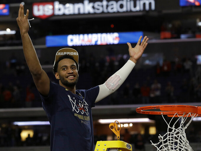 Virginia's Braxton Key celebrates after defeating Texas Tech 85-77 in the overtime in the championship of the Final Four NCAA college basketball tournament, Monday, April 8, 2019, in Minneapolis. (AP Photo/David J. Phillip)