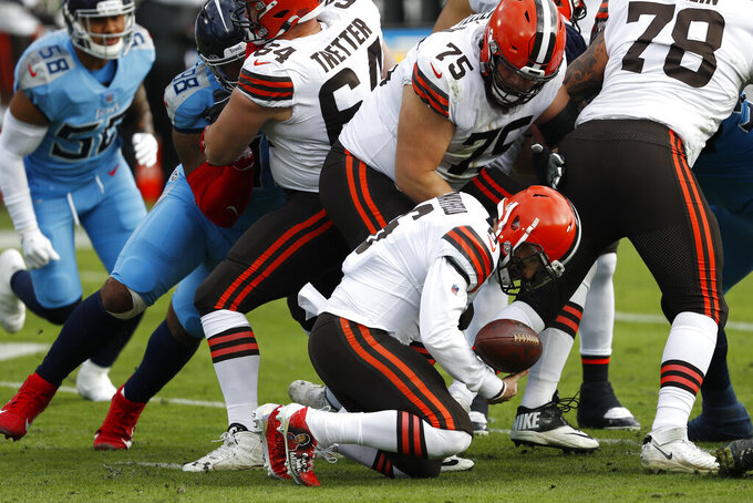 Cleveland Browns quarterback Baker Mayfield (6) recovers a loose ball in the first half of an NFL football game against the Tennessee Titans Sunday, Dec. 6, 2020, in Nashville, Tenn. (AP Photo/Wade Payne)