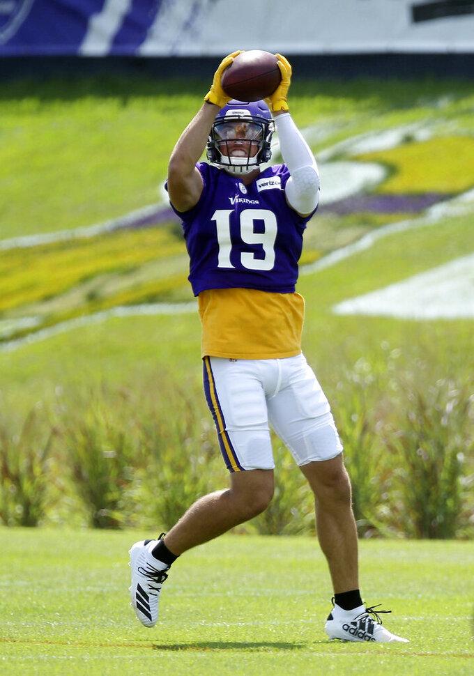 Minnesota Vikings wide receiver Adam Thielen catches a pass during the NFL football team's training camp Monday, July 29, 2019, in Eagan, Minn. (AP Photo/Jim Mone)