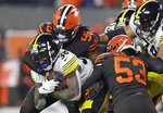 Pittsburgh Steelers running back Jaylen Samuels (38) tackled by Cleveland Browns defensive tackle Sheldon Richardson (98) and middle linebacker Joe Schobert (53) during the first half of an NFL football game, Thursday, Nov. 14, 2019, in Cleveland. (AP Photo/Ron Schwane)