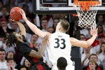 Cincinnati Bearcats center Chris Vogt (33) blocks a shot by Houston Cougars guard DeJon Jarreau (3) in the first half of an NCAA college basketball game, Saturday, Feb. 1, 2020, in Cincinnati. (Kareem Elgazzar/The Cincinnati Enquirer via AP)