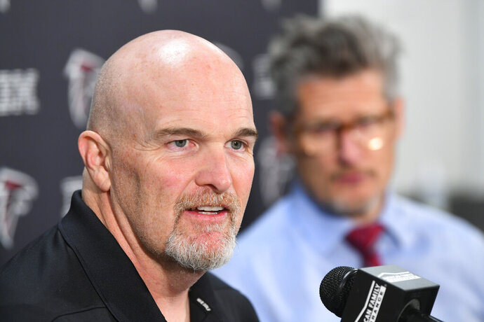 Atlanta Falcons coach Dan Quinn, left, and general manager Thomas Dimitroff face the media during a news conference held by the NFL football team, Monday, Dec. 30, 2019, in Flowery Branch, Ga. Quinn and Dimitroff were in the hot seat earlier this season after a poor start, but owner Arthur Blank made the decision to retain both of them last week. (John Amis/Atlanta Journal-Constitution via AP)
