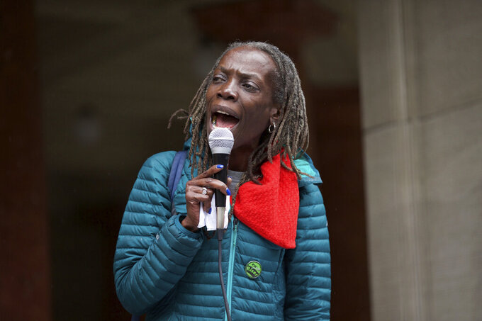 FILE - In this April 11, 2018, file photo, Jo Ann Hardesty speaks at a rally at City Hall in Portland, Ore. Portland Mayor Ted Wheeler and Commissioner Jo Ann Hardesty said Thursday, April 8, 2021, in a joint statement that Portland hired the independent OIR Group and wills spend up to $150,000 for an investigation that probes whether the Portland Police Bureau's culture, polities and actions are influenced by racial or political bias, the extent of the bias and how to address a potential problem. (Mark Graves/The Oregonian via AP, File)