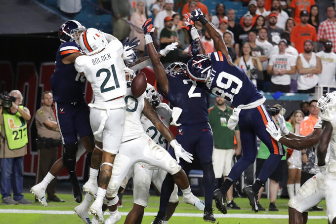Virginia wide receiver Joe Reed (2) and wide receiver Dejon Brissett (89) can't come up with the football on a pass thrown by quarterback Bryce Perkins in the closing seconds of an NCAA college football game Friday, Oct. 11, 2019, in Miami Gardens, Fla. Miami won 17-9. (AP Photo/Lynne Sladky)