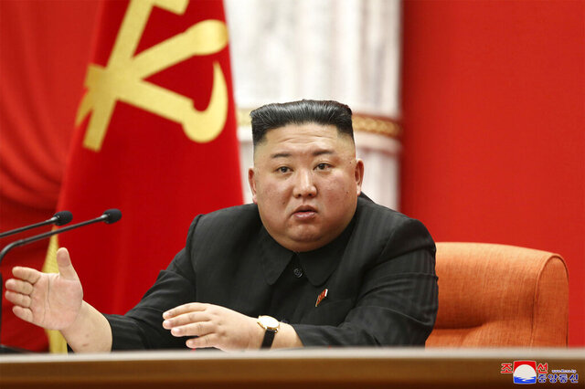 """In this photo provided by the North Korean government, North Korean leader Kim Jong Un speaks at the ruling party congress in Pyongyang, North Korean, Sunday, Jan. 10, 2021. Kim was given a new title, """"general secretary"""" of the ruling Workers' Party, formerly held by his late father and grandfather, state media reported Monday, Jan. 11, in what appears to a symbolic move aimed at bolstering his authority amid growing economic challenges. Independent journalists were not given access to cover the event depicted in this image distributed by the North Korean government. The content of this image is as provided and cannot be independently verified. Korean language watermark on image as provided by source reads:"""