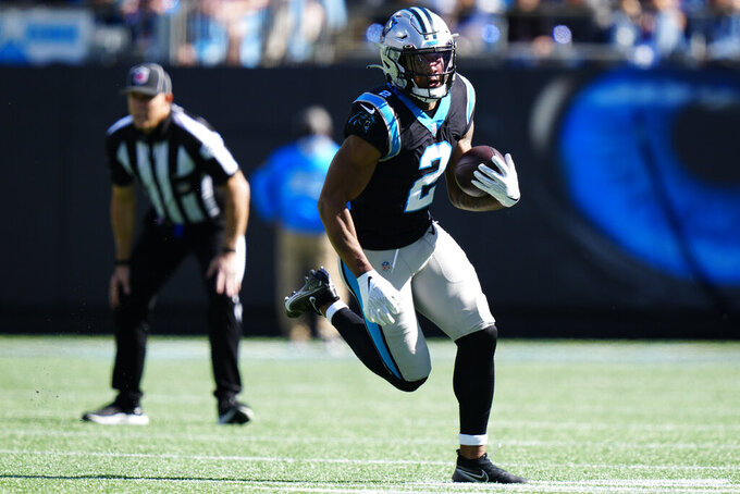 Carolina Panthers wide receiver D.J. Moore (2) runs against the Minnesota Vikings during the first half of an NFL football game, Sunday, Oct. 17, 2021, in Charlotte, N.C. (AP Photo/Jacob Kupferman)