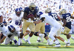Navy Nelson Smith runs in the second quarter of an NCAA college football game against Holy Cross, Saturday, Aug. 31, 2019, in Annapolis, Md. (Paul W. Gillespie/Capital Gazette via AP)