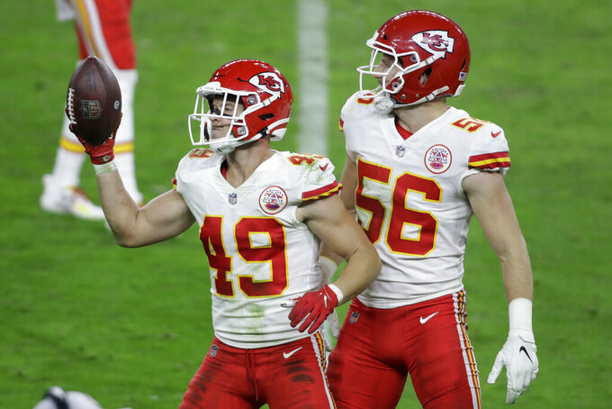 Kansas City Chiefs free safety Daniel Sorensen (49) celebrates after making an interception against the Las Vegas Raiders during the second half of an NFL football game, Sunday, Nov. 22, 2020, in Las Vegas. (AP Photo/Isaac Brekken)