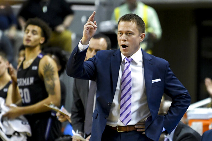 Furman coach Bob Richey react to a play during the first half of the team's NCAA college basketball game against Auburn on Thursday, Dec. 5, 2019, in Auburn, Ala. (AP Photo/Julie Bennett)