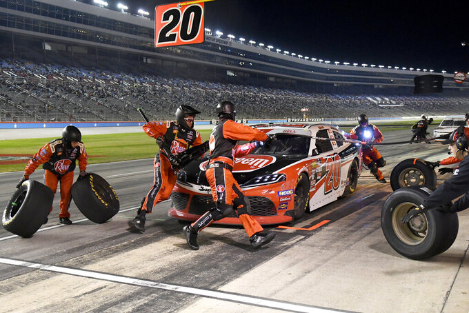 Christopher Bell makes a pit stop during the NASCAR Xfinity Series auto race at Texas Motor Speedway in Fort Worth, Texas, Saturday, Nov. 2, 2019. (AP Photo/Larry Papke)