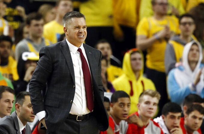 FILE - In this Tuesday, Jan. 29, 2019, file photo, Ohio State head coach Chris Holtmann reacts on the sidelines during the second half of an NCAA college basketball game against Michigan in Ann Arbor, Mich. Ohio State is limping through a rare skid in which the Buckeyes have lost five of the last six games.  (AP Photo/Carlos Osorio, File)
