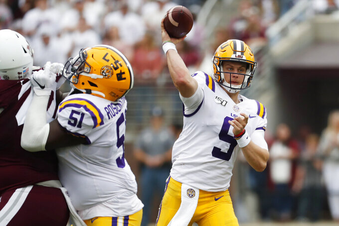 LSU quarterback Joe Burrow (9) passes against Mississippi State during the first half of their NCAA college football game in Starkville, Miss., Saturday, Oct. 19, 2019. (AP Photo/Rogelio V. Solis)