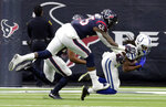 Indianapolis Colts wide receiver T.Y. Hilton (13) pulls in a catch in front of Houston Texans inside linebacker Benardrick McKinney (55) during the first half of an NFL wild card playoff football game, Saturday, Jan. 5, 2019, in Houston. (AP Photo/Michael Wyke)