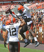 Cleveland Browns tight end David Njoku leaps up to spike the ball after a touchdown on an 11-on-11 drill during an Orange and Brown NFL football practice in Cleveland, Sunday, Aug. 8, 2021. (Joshn Kuntz/The Plain Dealer via AP)
