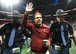 FILE - In this Dec. 1, 2018, file photo, Alabama head coach Nick Saban leaves the field after the Southeastern Conference championship NCAA college football game against Georgia in Atlanta. UCF's Josh Heupel, Notre Dame's Brian Kelly and Saban are the finalists for The Associated Press national college football coach of the year after leading their teams to unbeaten regular seasons. The winner will be announced Monday, Dec. 17. (AP Photo/John Amis, File)
