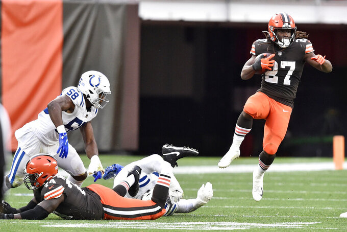 Cleveland Browns running back Kareem Hunt (27) runs after a catch during the first half of an NFL football game against the Indianapolis Colts, Sunday, Oct. 11, 2020, in Cleveland. (AP Photo/David Richard)