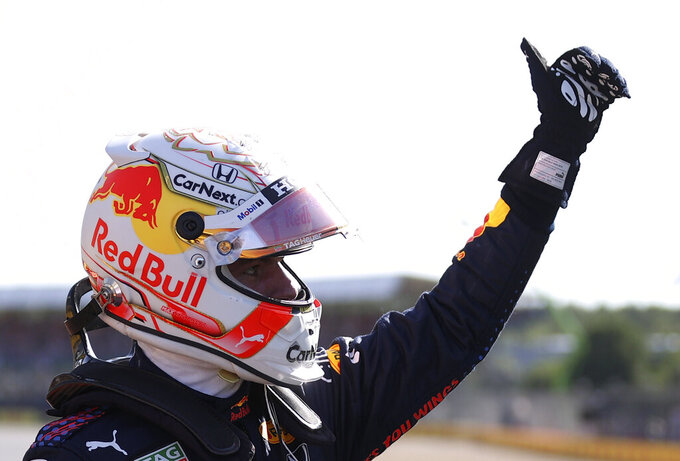 Red Bull driver Max Verstappen of the Netherlands waves to fans after finishing first in the Sprint Qualifying of the British Formula One Grand Prix, at the Silverstone circuit, in Silverstone, England, Saturday, July 17, 2021. The British Formula One Grand Prix will be held on Sunday. (Lars Baron/Poolvia AP)