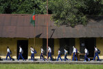 Students arrive at the Narinda Government High School as schools reopen after being closed for nearly 18 months due to the coronavirus pandemic in Dhaka, Bangladesh, Sunday, Sept.12, 2021. (AP Photo/Mahmud Hossain Opu)