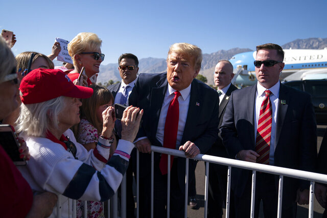 President Donald Trump greets supporters after arriving at Palm Springs International Airport, in Palm Springs, Calif., en route to a fundraiser in Rancho Mirage, Calif., Wednesday, Feb. 19, 2020, in Palm Springs, Calif. (AP Photo/Evan Vucci)