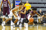 Missouri's Mark Smith, left, and Southern Illinois' Lance Jones, right, battle for the ball during the first half of an NCAA college basketball game Sunday, Dec. 15, 2019, in Columbia, Mo. (AP Photo/L.G. Patterson)