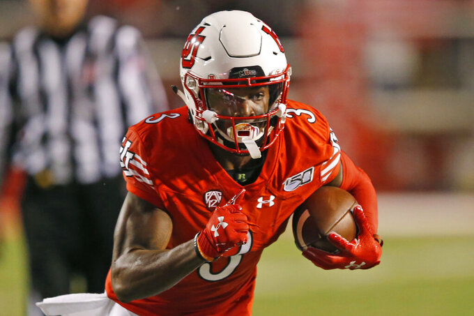 Utah wide receiver Demari Simpkins (3) carries the ball against Washington State in the first half of an NCAA college football game Saturday, Sept. 28, 2019, in Salt Lake City. (AP Photo/Rick Bowmer)