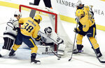 Los Angeles Kings goaltender Calvin Petersen (40) stops a shot by Nashville Predators right wing Ryan Hartman (38) during the first period of an NHL hockey game Saturday, Nov. 17, 2018, in Nashville, Tenn. (AP Photo/Mark Zaleski)