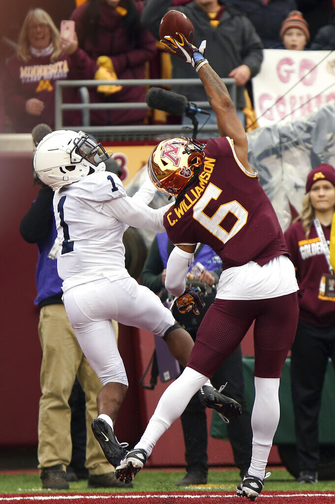 Minnesota defensive back Chris Williamson (6) tips the ball in the end zone away from the arms of Penn State wide receiver KJ Hamler (1) during an NCAA college football game, Saturday, Nov. 9, 2019, in Minneapolis. Minnesota won 31-26. (AP Photo/Stacy Bengs)