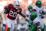 FILE - In this Sept. 21, 2019, file photo, Stanford running back Austin Jones (20) stiff-arms Oregon cornerback Thomas Graham Jr. (4) during the second half of an NCAA college football game in Stanford, Calif. Stanford head coach David Shaw has a long list of capable sophomores who gained valuable experience even if some didn't play and will be called upon to take on bigger roles now in their second seasons. Jones finished with 227 yards rushing with one touchdown on 45 carries and also made 14 catches for 108 yards. (AP Photo/Tony Avelar, File)