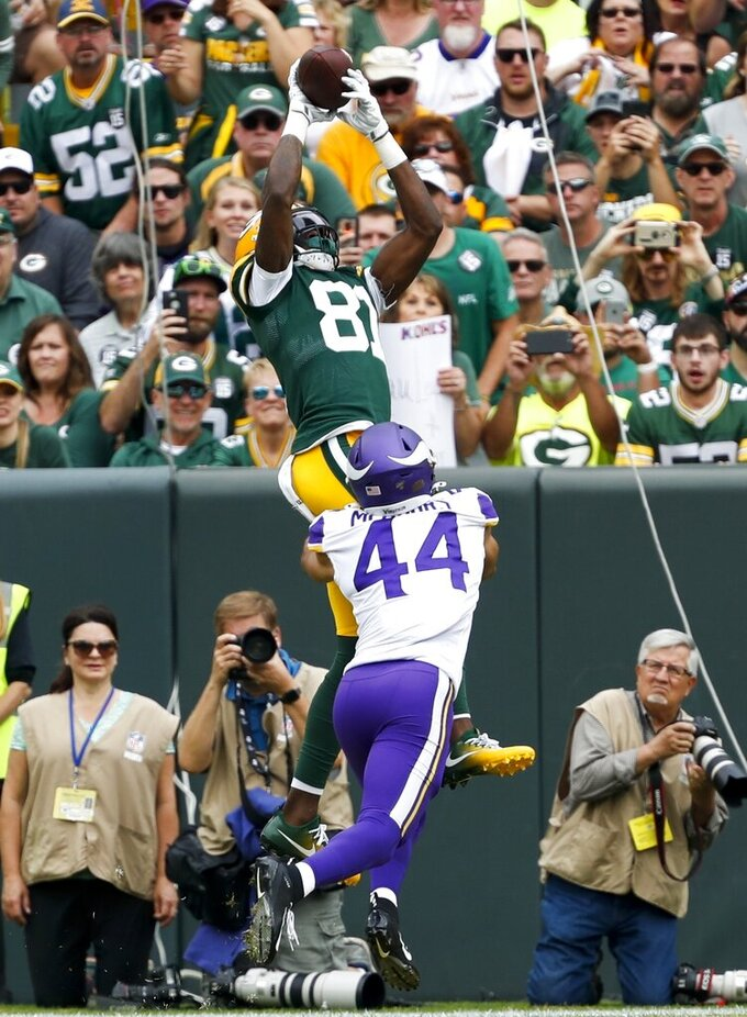 Green Bay Packers' Geronimo Allison catches a touchdown pass over Minnesota Vikings' Nate Meadors during the first half of an NFL football game Sunday, Sept. 15, 2019, in Green Bay, Wis. (AP Photo/Matt Ludtke)