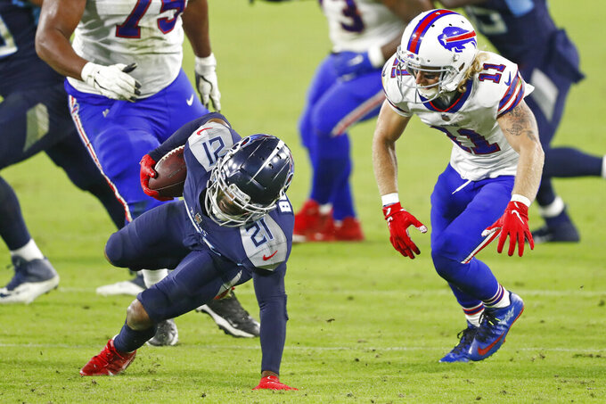 Tennessee Titans cornerback Malcolm Butler (21) intercepts a pass as Buffalo Bills wide receiver Cole Beasley (11) tries to bring him down in the second half of an NFL football game Tuesday, Oct. 13, 2020, in Nashville, Tenn. (AP Photo/Wade Payne)