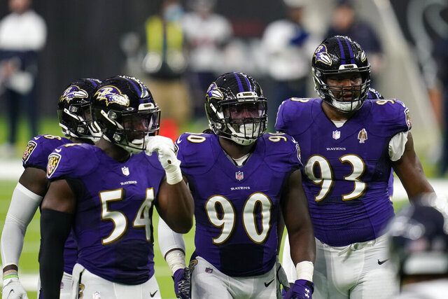 Baltimore Ravens defenders Pernell McPhee (90) Calais Campbell (93) prepare for the next play during an NFL football game against the Houston Texans, Sunday, Sept. 20, 2020, in Houston. In the midst of an NFL season that is course to set records for the most points and touchdowns, the Baltimore Ravens and Pittsburgh Steelers are winning on the strength of their defense. (AP Photo/Matt Patterson)